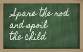 Expression - Spare the rod and spoil the child - written on a s — Stok fotoğraf