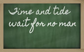 Expression - Time and tide wait for no man - written on a schoo — Stock Photo