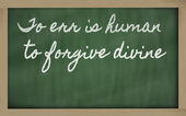 Expression - To err is human, to forgive divine - written on a — Stock Photo