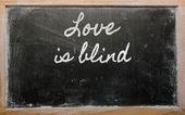 Expression - Love is blind - written on a school blackboard wit — Stock Photo