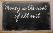 Expression - Money is the root of all evil - written on a schoo — Stock Photo