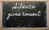 Expression - Silence gives consent - written on a school blackb — Stock Photo