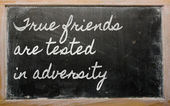 Expression - True friends are tested in adversity - written on — 图库照片