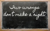 Expression - Two wrongs don't make a right - written on a schoo — Zdjęcie stockowe