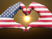 Heart and love gesture by hands colored in usa flag during beaut — Stock Photo