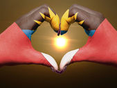 Heart and love gesture by hands colored in antigua barbuda flag — Stock Photo