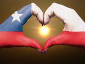 Heart and love gesture by hands colored in chile flag during bea — Stock Photo