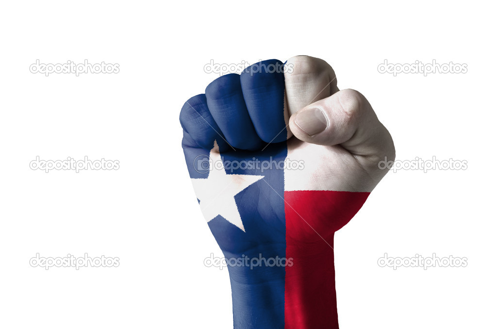 Low key picture of a fist painted in colors of american state flag of texas — Stock Photo #9861769