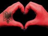 Heart and love gesture by hands colored in albania flag for tour — Stock Photo