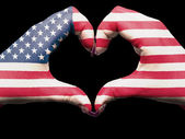 Heart and love gesture by hands colored in usa flag for tourism — Stock Photo