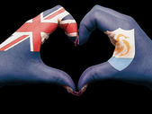 Heart and love gesture by hands colored in anguilla flag for tou — Stock Photo