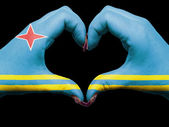 Heart and love gesture by hands colored in aruba flag for touris — Zdjęcie stockowe