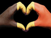 Heart and love gesture by hands colored in belgium flag for tour — Stock Photo
