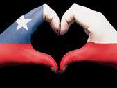 Heart and love gesture by hands colored in chile flag for touris — Foto de Stock