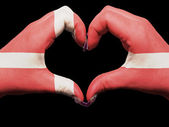 Heart and love gesture by hands colored in denmark flag for tour — Stock Photo