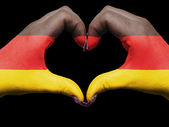 Heart and love gesture by hands colored in germany flag for tour — Stock Photo