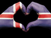 Heart and love gesture by hands colored in iceland flag for tour — Stock Photo