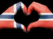 Heart and love gesture by hands colored in norway flag for touri — Stock Photo