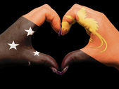 Heart and love gesture by hands colored in papua new guinea flag — Stock Photo