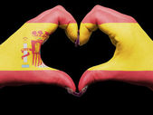 Heart and love gesture by hands colored in spain flag for touris — Foto de Stock