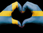 Heart and love gesture by hands colored in sweden flag during fo — Stock Photo