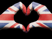 Heart and love gesture by hands colored in united kingdom flag f — Stock Photo