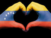 Heart and love gesture by hands colored in venezuela flag for t — Stock Photo