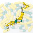 Outline map of japan with pills in the background for health and — Stock Photo