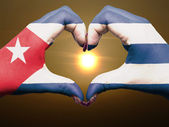 Heart and love gesture by hands colored in cuba flag during beau — Stock Photo