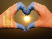 Heart and love gesture by hands colored in mongolia flag during — Stock Photo