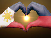 Heart and love gesture by hands colored in philippines flag duri — Stock Photo
