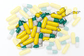 Outline map of afghanistan with pills in the background for heal — Stock Photo