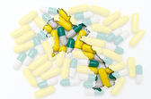 Outline map of laos with pills in the background for health and — Stock Photo