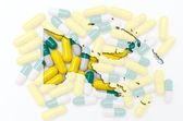 Outline map of papua new guinea with pills in the background for — Stock Photo