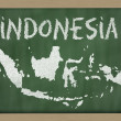 Outline map of indonesia on blackboard — Foto de Stock