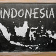 Outline map of indonesia on blackboard — ストック写真