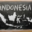 Outline map of indonesia on blackboard — Stock Photo