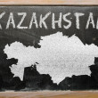Stock Photo: Outline map of kazakhston blackboard