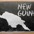 Outline map of new guinea on blackboard — Zdjęcie stockowe