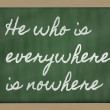 Expression -  He who is everywhere is nowhere - written on a sch - Stock Photo
