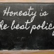 ������, ������: Expression Honesty is the best policy written on a school b