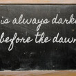 Stock Photo: Expression - It is always darkest before dawn - written on