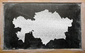 Outline map of kazakhstan on blackboard — Stockfoto