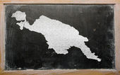 Outline map of new guinea on blackboard — Stockfoto