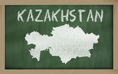 Outline map of kazakhstan on blackboard — Stock Photo
