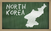 Outline map of north korea on blackboard — Stock Photo