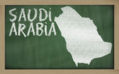 Outline map of saudi arabia on blackboard — Zdjęcie stockowe