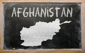 Outline map of afghanistan on blackboard — Stock Photo