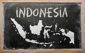 Outline map of indonesia on blackboard — Stock Photo
