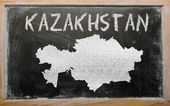 Outline map of kazakhstan on blackboard — Fotografia Stock